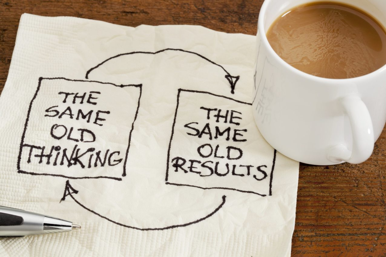 Writing on napkin with coffee on top depicting the same old results that come from the same old thinking