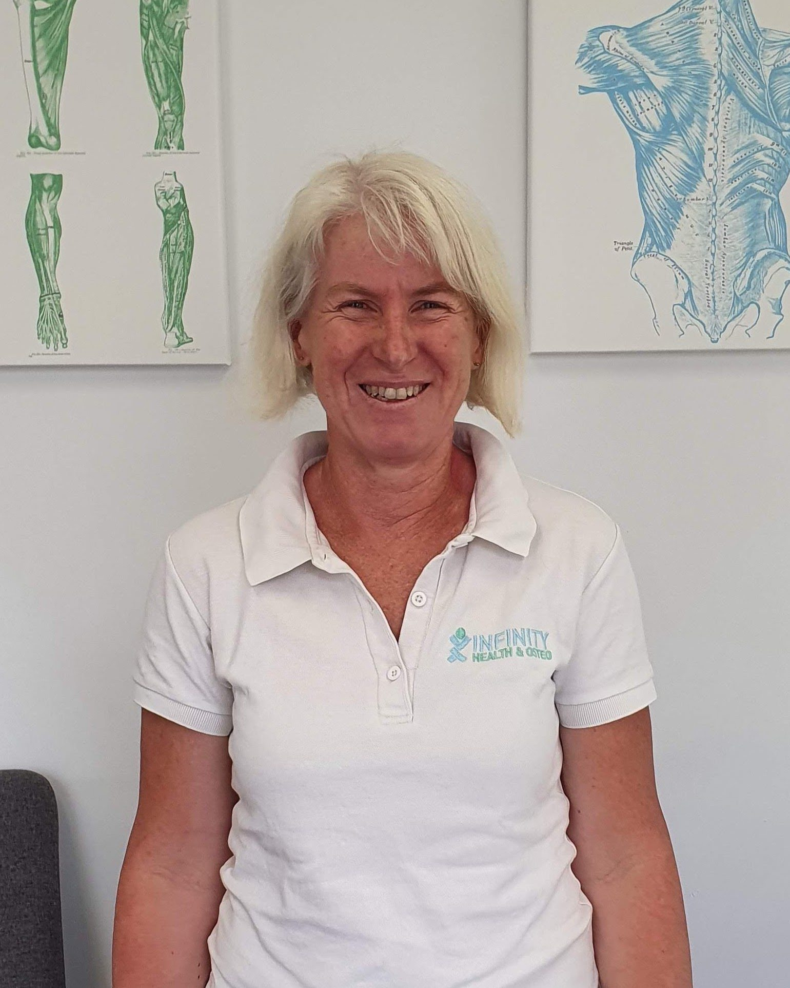 Remedial massage therapist Margit smiling in Infinity uniform at templestowe clinic