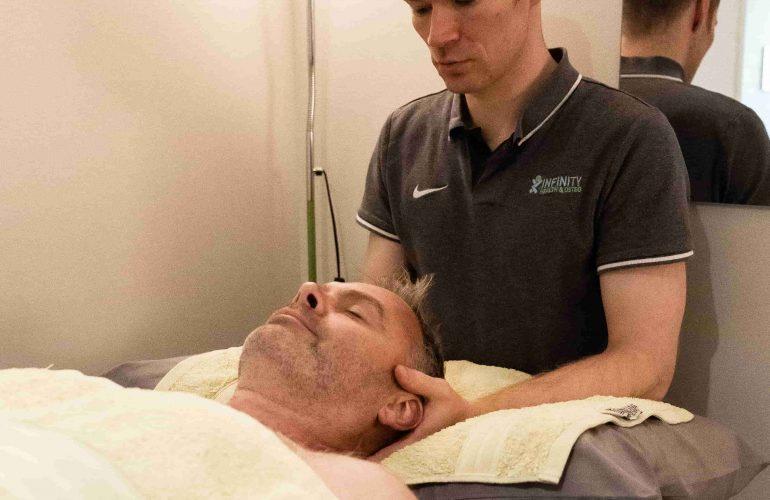 Evan treating neck