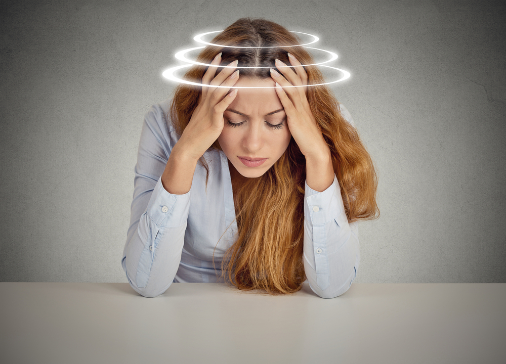 Young female patient suffering from dizziness